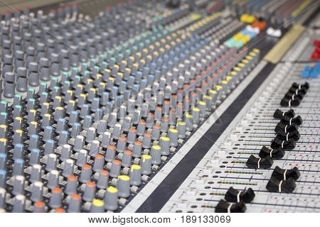 Professional Sound mixing console with many knobs
