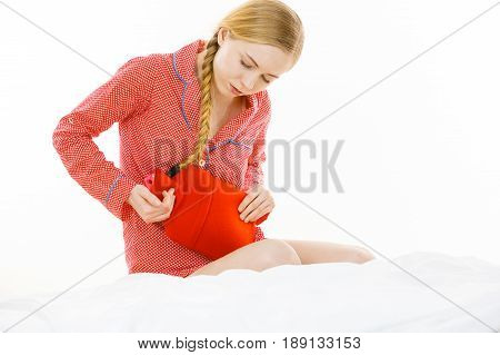 Woman Feeling Stomach Cramps Lying On Bed