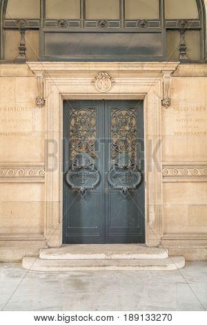 Paris, France, March 28 2017: Door architectural exteriors details of the Louvre museum
