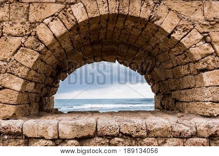 A view of the Mediterranean sea through one of the archways of the Roman aqueduct at Caesarea Maritima in Israel