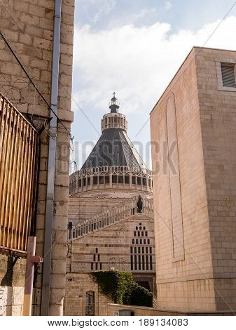 The Basilica of the Annunciation where it is believed the angel Gabriel appeared to Mary as seen through the narrow streets of Nazareth in Israel.