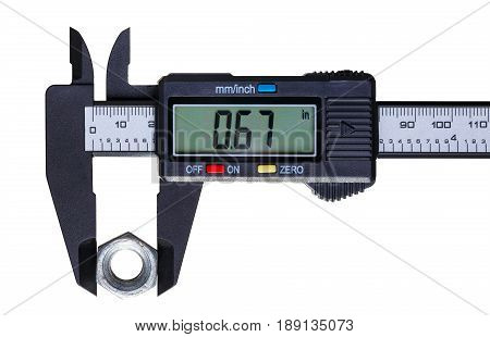 The digital caliper measures the diameter of the old nut. Objects isolated on white background.