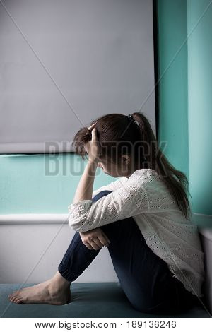 woman feel depression and sit on the bed
