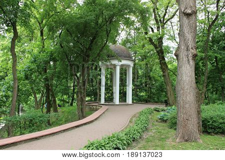 Alcove in the park, trees, bushes, path