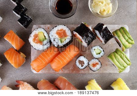 Close Up Of Sashimi Sushi Set With Chopsticks And Soy - Sushi Roll With Salmon And Sushi Roll With S