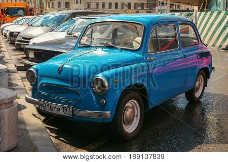 Russia, Moscow, Mary 23, 2017. Moscow streets, vintage car on Old Arbat