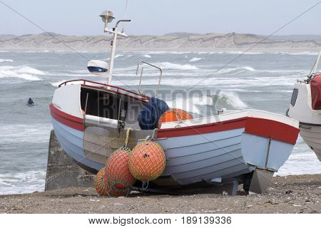 Stock Photo of Danish fishing boat on the beach