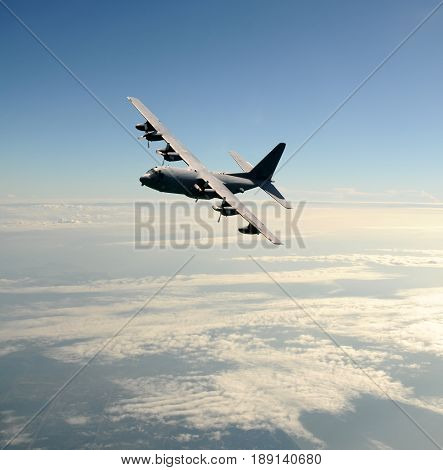 Military cargo airplane in high altitude flight