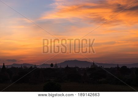 Sunset with abstract flame shape cloud and colorful twilight sky background in Old Bagan Myanmar