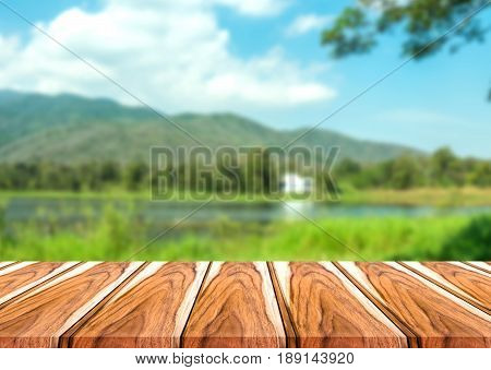 Selected focus empty brown wooden table and outdoors or nature blur background image. for your photomontage or product display.