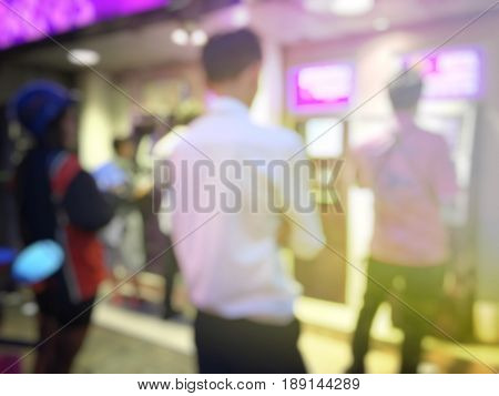 Blurred Image Of People Queuing To Withdraw Money From Atm In The Bank In Night Time Of The End Of M
