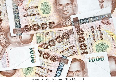 one thousand baht pile as background.Thai money banknotes closeup background
