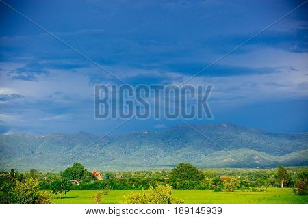 Mountain ridge in thailand vintage color grading style show wonderful scene of rice field and rural area.