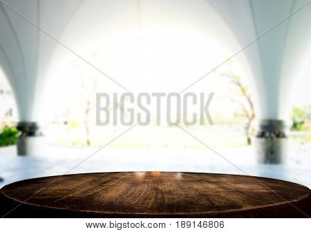 Selected focus empty brown wooden table and white texture or outdoors blur background image. for your photomontage or product display