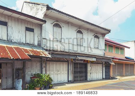 Yasothon, Thailand - May 2017: Classic Sino-Portuguese architectural style shophouse building at Ban Singha Tha old historic area of Yasothon Province in the northeastern region of Thailand
