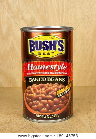 RIVER FALLS,WISCONSIN-JUNE 01,2017: A can of Bush's home-style baked beans with a wood background.