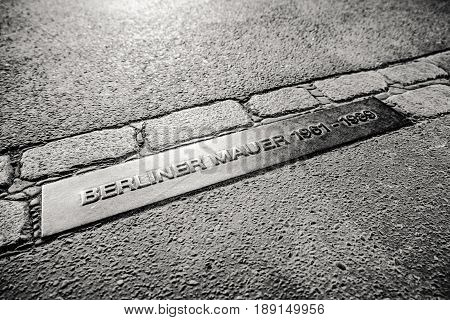 BERLIN GERMANY - APRIL 8: Memorable table Berliner mauer - Berlin wall on April 8 2017 in Berlin
