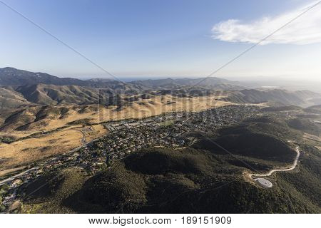 Aerial view of suburban housing and Santa Monica Mountains Parks in Newbury Park near Los Angeles, California.