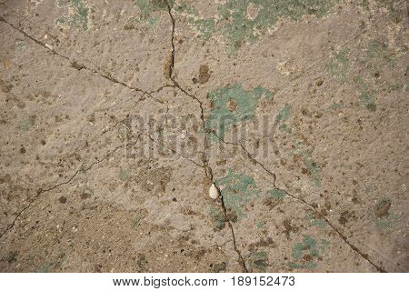 Crack wall texture and paint.Abstract background. Painted blue and green cracked wall
