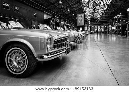 BERLIN - MAY 13 2017: Retro cars stand in a row in the center of competence for classic cars and youngtimers - Classic Remise. Black and white. Exhibition