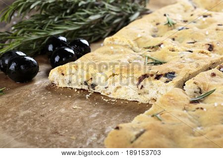Italian focaccia bread with olives and rosemary.