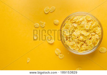 Corn Flakes On A Yellow Background. Breakfast Concept
