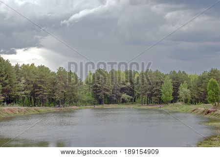 A Small Lake Surrounded By Forest
