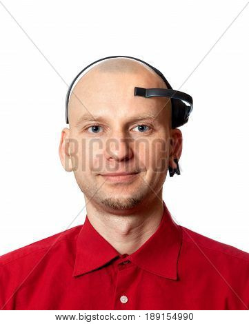 Portrait of young man with electroencephalography (EEG) headset on head. Isolated on white background.