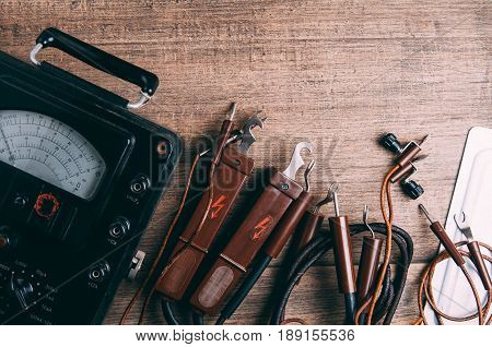 Old tools for electrician. The concept industry
