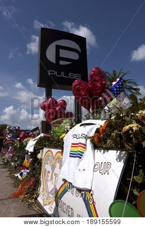 ORLANDO, FLORIDA - June 29, 2016: Pulse victim's memorial at the Pulse Night Club on June 29, 2016 in Orlando, Florida. Flowers and other memorials left at the site of the terrorist attack that killed 49 people on June 12, 2016.