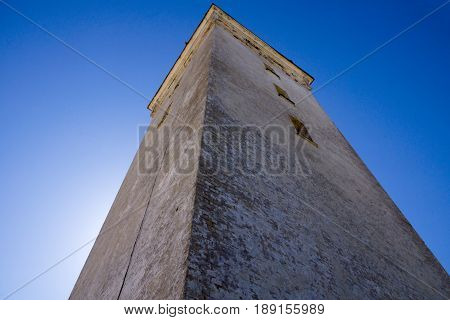 Rubjerg knude old lighthouse wide angle on sea water against blue sky horiozntal
