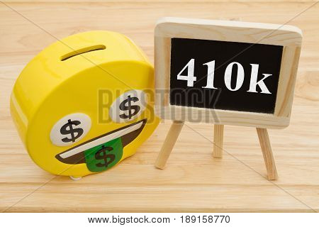 Learning how to save for your retirement A coin bank on a desk with chalkboard with text 401k