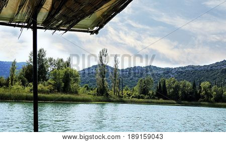 peacefully boating on lake Bacina in Croatia