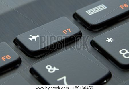 Airplane mode button on laptop keyboard; Close-up view