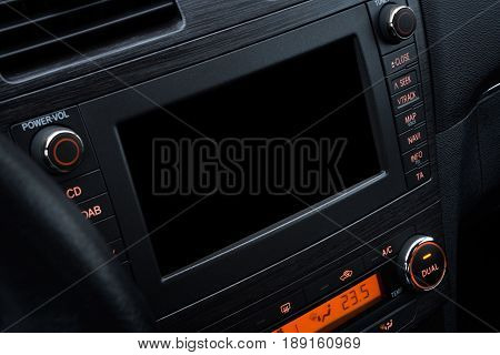 Modern car interior design; Car console with board computer touch screen for multimedia and navigation system mockup. Closeup view
