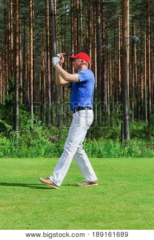 VIERUMAKI FINLAND June 23: A golfer played a shot at the meow at the sports centre for a game of Golf Vierumaki June 23 2015.