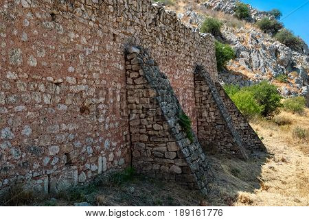 Fragment of the old fortress wall of the ancient Akrocorinth. Peloponnese Greece.