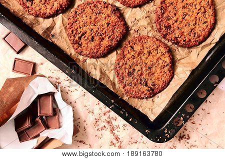 Freshly baked  cookies with chocolate on tray.