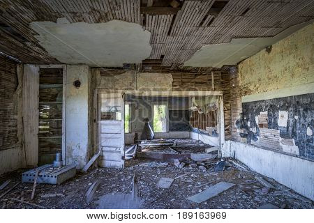 ruined interior of an old abandoned school house in rural Nebraska