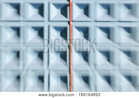 Abstract motion blur background of blue concrete wall with square cells geometrical pattern