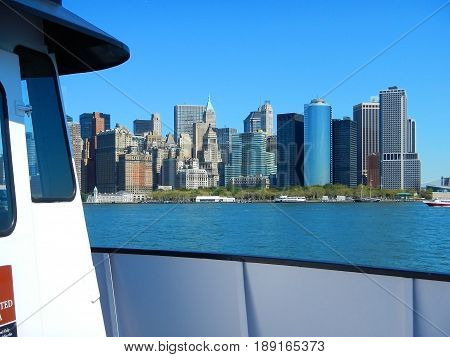 Upper bay boat view on NYC New York Manhattan buildings skyscrapers offices, piers. NYC architecture. Boat trip to Statue of Liberty. Famous sightseeing NYC places for tourists. NYC boat trips