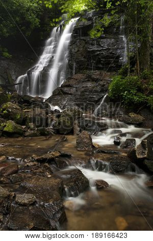 Waters flowing over the beautiful Soco Falls, in western North Carolina during springtime near Maggie Valley