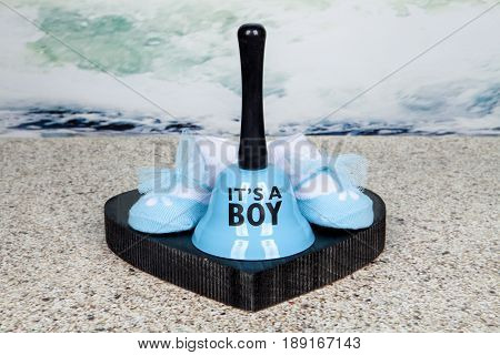 Booties and a bell celebrate the birth of a baby boy