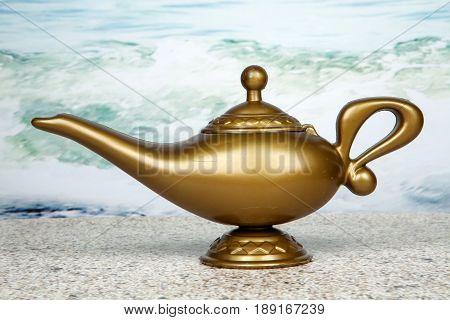 A genie lamp against an ocean background