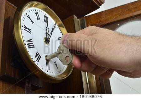Hand Winding A Wall Clock