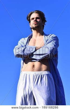 Caucasian Macho In Blue Striped Pajamas