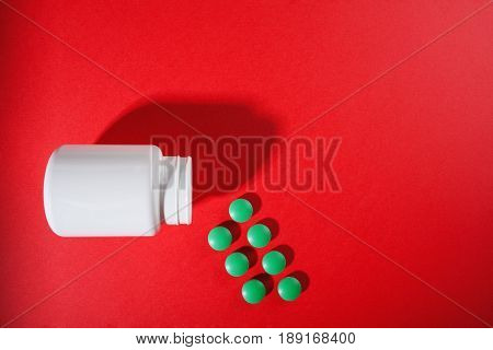 Medical Pills On A Colored Background With A White Vial