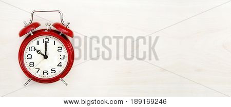 Time concept - website banner of a retro red alarm clock