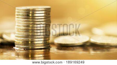 Business success concept - website banner of golden money coins