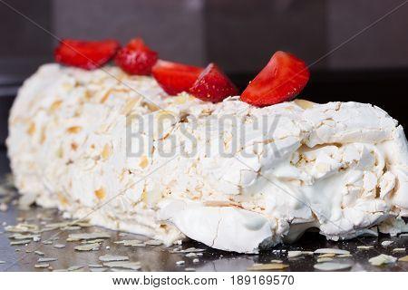 strawberry cake . Pavlova - meringue cake with fresh strawberries. meringue roulade with creamstrawberries and raspberries